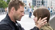 In the cliched thriller Erased, ex-CIA agent Ben Logan (Aaron Eckhart) and his daughter Amy (Liana Liberato) go on the run when they become targets of a wide-reaching conspiracy.