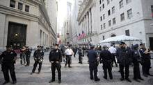 Policemen stand guard around the New York Stock Exchange as Participants in Occupy Wall Street demonstrate around Wall Street, in New York, September 19, 2011. (EMMANUEL DUNAND/AFP/Getty Images/EMMANUEL DUNAND/AFP/Getty Images)