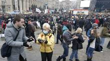 Anti-government protesters gather stones during a rally in central Kiev February 19, 2014. (VASILY FEDOSENKO/REUTERS)