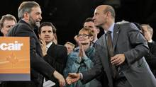 Thomas Mulcair shakes hands with third-place candidate Nathan Cullen after the Quebec MP won on the fourth ballot at the NDP leadership convention in Toronto on March 24, 2012. (Fred Lum/Fred Lum/The Globe and Mail)