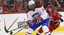Montreal Canadiens' P.K. Subban controls the puck as Carolina Hurricanes' Eric Staal (12) chases during the first period of an NHL game in Raleigh, N.C., Thursday, April 5, 2012. (Associated Press)