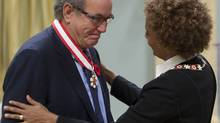 Title: stf Caption: Governor General Michaelle Jean invests Buzz Hargrove as an Officer of the Order of Canada during a ceremony in Ottawa, Thursday Nov. 5, 2009. THE CANADIAN PRESS/ Adrian Wyld (Adrian Wyld)