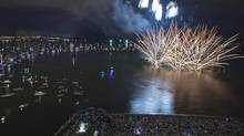 Thousands of people gather on shore and on boats during the annual Celebration of Light over English Bay in Vancouver, British Columbia July 30, 2011. (REUTERS/Andy Clark/REUTERS/Andy Clark)