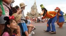 Disney characters entrance visitors to the Magic Kingdom at Disney World in Orlando, Fla. (Gregg Matthews/NYT)