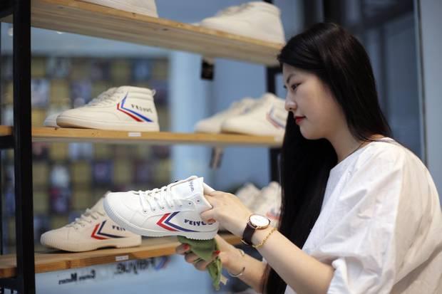 Designer Amy Li prepares Feiyue sneakers for sale in Shanghai.