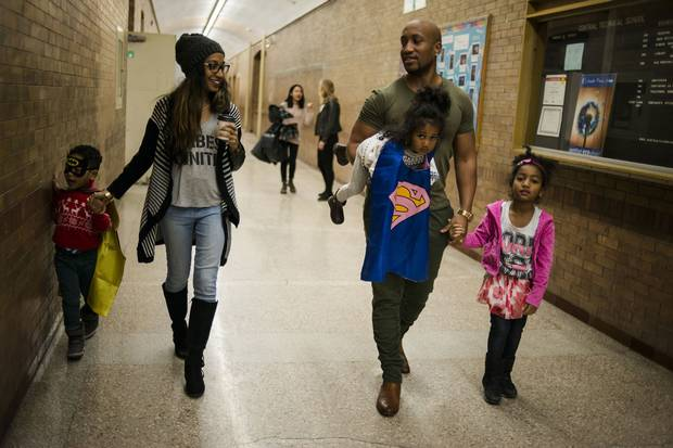 Jhanelle and Andrew Alleyne walk with their children – Zion, Zoe and Zyrah – to the child-care facilities C3 offers during worship.