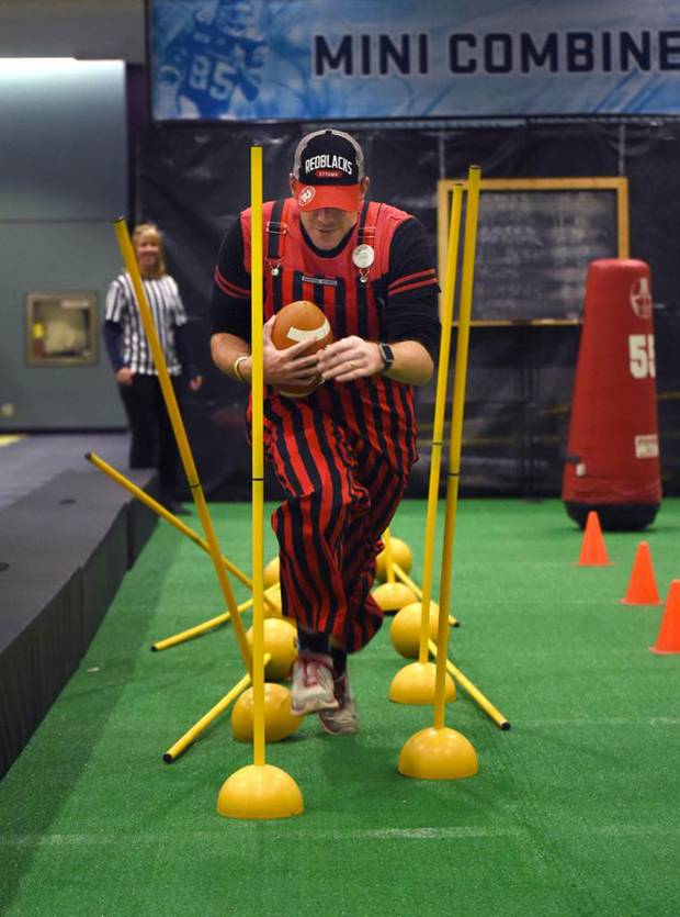 Ottawa RedBlacks fan Jordan Fleck takes part in the Mini Combine test during fan events at the Metro Toronto Convention Centre on Nov 24 2016. Fleck and about twenty of his friends flew down from Ottawa to take in the 104th Grey Cup game between the Ottawa RedBlacks and the Calgary Stampeders this weekend.