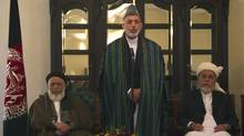 Afghan President Hamid Karzai (C) speaks flanked by former Afghan President Burhanuddin Rabani (L) and former Mujahadin leader Pir Sayed Ahmad Gilani during the inauguration ceremony for the High Peace Council. (Ahmad Masood/Reuters/Ahmad Masood/Reuters)