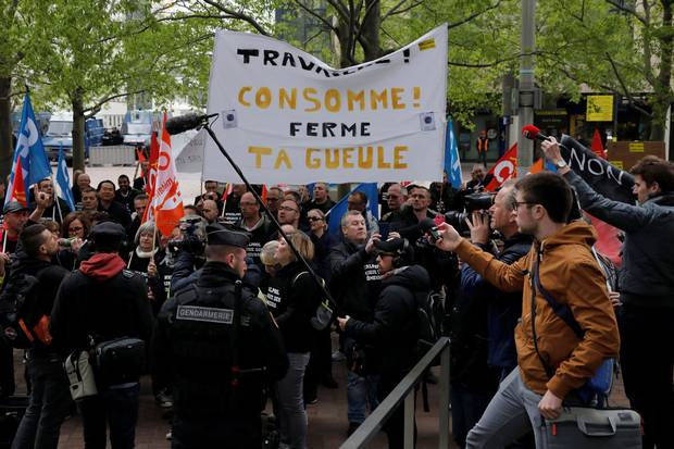 Whirlpool Amiens factory union employees demonstrate outside the company headquarters at the financial and business district of La Defense, west of Paris.