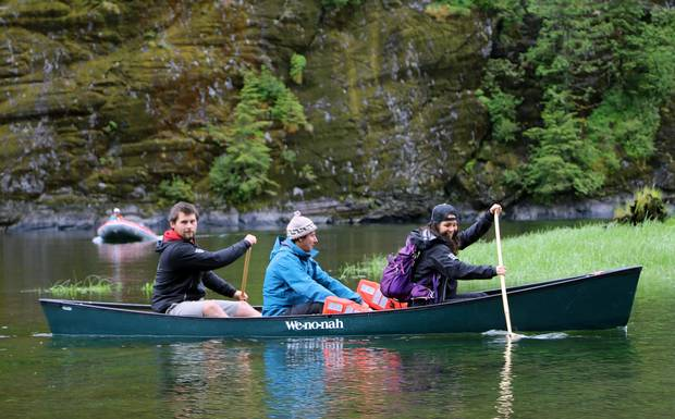 Kitasoo/Xai'xais watchman staff, including Chantal Pronteau, paddling at the front. Taken in Fiordland Conservancy.