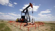 A Canadian Natural Resources pump jack pumps oil out of the ground near Dorothy, Alberta, June 30, 2009. (TODD KOROL/REUTERS)