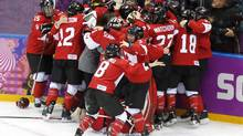 A victory to savour: Team Canada celebrates its win over the U.S. women to win the gold medal on Thursday. (John Lehmann/The Globe and Mail)