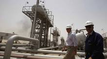 Michael Townshend, left, president of BP Iraq, walks with an official of South Oil Company at the Rumaila oil field in Basra, Iraq, in this 2010 file photo. (ATEF HASSAN/REUTERS)