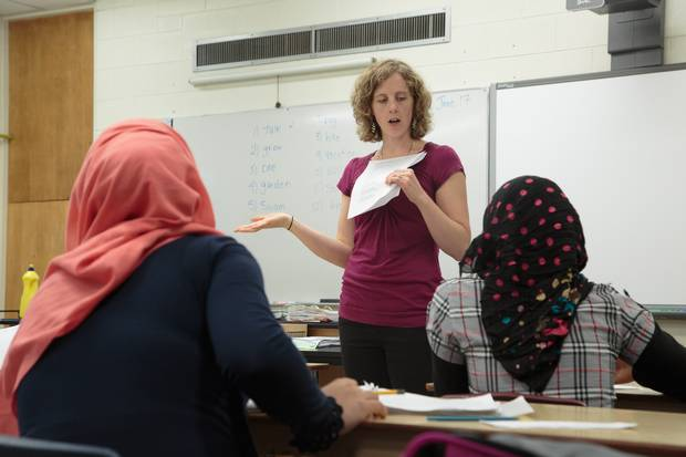 Teacher Vanessa Zacharias addresses her English class at W.C. Miller Collegiate on the last day of school. Her students have made significant progress in spoken and written English since beginning their studies.