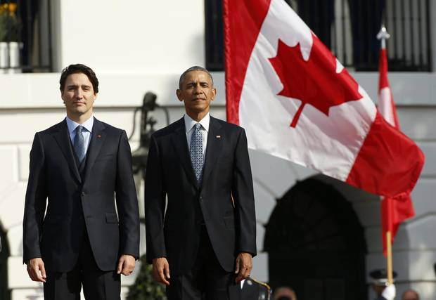 U.S. President Barack Obama and Canadian Prime Minister Justin Trudeau listen to national antherms during Thursday's arrival ceremony at the White House.
