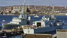 The frigate HMCS Charlottetown, right, sits in Halifax harbour on March 1, 2011, as it prepares to deploy to Libya. (ANDREW VAUGHAN/The Canadian Press)