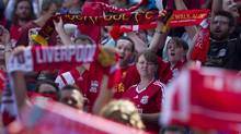 "Liverpool's fans sing the Anfield anthem ""You'll Never Walk Alone"" ahead of their team's game against Toronto FC in their friendly match in Toronto on Saturday, July 21, 2012. (Chris Young/The Canadian Press)"