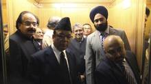Sushil Kumar Modi, centre, says India will not follow B.C.'s lead and have a referendum on taxes. gets into an elevator with his group on Parliament Hill in Ottawa. Modi is leading a delagation to study the Canadian GST system. DAVE CHAN for The Globe and Mail (Dave Chan For the Globe and Mail)