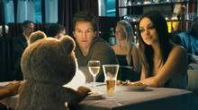 "Ted, voiced by Seth MacFarlane, Mark Wahlberg and Mila Kunis in a scene from ""Ted"" (Photo Credit: Universal Pictures/Universal Pictures)"