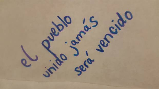 One message, in Spanish, reads: 'The people united will never be defeated.'