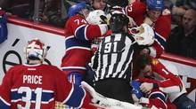 Montreal Canadiens goalie Carey Price looks on as his team fights with players of Florida Panthers during