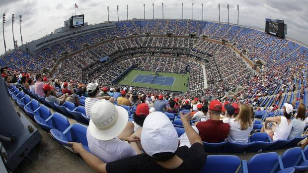 Spectators watch a match between Julien Benneteau, of France, and Serbia's Novak Djokovic in the third round of play at the 2012 U.S. Open, Sunday, Sept. 2, 2012, in New York. (Mike Groll/AP)