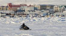 Why yes, that is Prime Minister Stephen Harper riding a snow mobile in Frobisher Bay in Iqaluit, Nunavut on Thursday, February 23, 2012. (Sean Kilpatrick/THE CANADIAN PRESS)