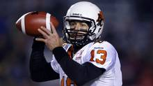 BC Lions' quarterback Mike Reilly looks to throw a pass during the first half of their CFL football game against the Calgary Stampeders in Calgary, Alberta, October 26, 2012 (Reuters)