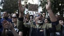 Protesters shout slogans during an anti-bailout rally outside the parliament in Nicosia on Monday. (YORGOS KARAHALIS/REUTERS)