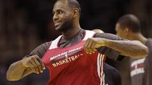 Miami Heat forward LeBron James warms up during basketball practice on Wednesday, June 4, 2014 in San Antonio. (Eric Gay/AP)
