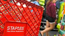 Customers walk past a Staples Inc. shopping cart inside of a store in Mount Prospect, Illinois, on Aug. 13, 2011. (Tim Boyle/Bloomberg)