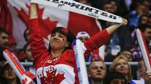 Not only did Canadians show their love of country while piling up 25 medals in Sochi, Russia, they possessed a noticeable swagger born with the success of the 2010 Vancouver-Whistler Winter Games. (Julio Cortez/AP)