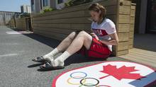 Basketball player Courtnay Pilypaitis surfs the internet during some downtime at the Canadian residence in the athletes' village at the 2012 London Olympics, on July 26. (Jason Ransom/THE CANADIAN PRESS)