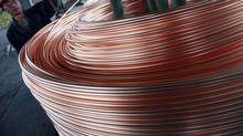 An employee unloads copper at a factory in Nantong, China, in this file photo. (Reuters)