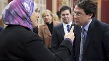 Democratic Institutions Minister Bernard Drainville, right, has said the charter's ban religious articles is 'an essential and inescapable condition of the bill.' (Jacques Boissinot/THE CANADIAN PRESS)