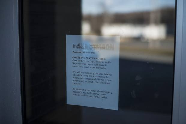 A water advisory is posted on the door to Paqtnkek's community centre.