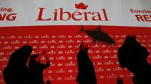 The shadow of small remote controlled shark flies above the heads of delegates at the federal Liberal convention in Ottawa on Jan. 14, 2012. (Peter Power/The Globe and Mail)