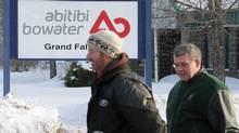 Workers leaves the AbitibiBowater paper mill in Grand Falls-Windsor, N.L., after the company shut down production Thursday Feb. 12, 2009. (Tara Brautigam/The Canadian Press)