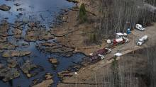 Crews clean up a pipeline break northeast of Peace River, Alta., on Wednesday. (Ian Jackson/THE CANADIAN PRESS)
