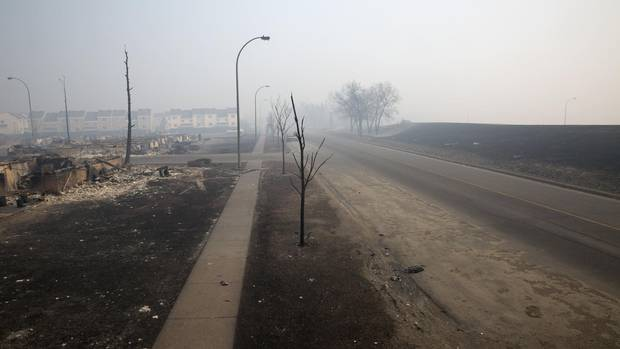 Gutted homes and smoky streets in the Beacon Hill neighborhood of Fort McMurray.