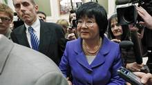 International Co-operation Minister Bev Oda is escorted past journalists after testifying before a Commons committee investigating contempt charges against her on March 18, 2011. (CHRIS WATTIE/REUTERS)