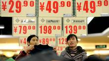 According to the government statistics, the October CPI number of 4.4 per cent which prompted the Chinese stock market selloff was composed almost entirely of dearer food. (STR/AFP/Getty Images)