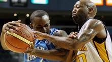 Halifax Rainmen's Chris Hagan drives to the basket as London Lightning's Eddie Smith tries to get a hand on the ball in National Basketball League (NBL) championships series game one, second half action in London, Ontario, Sunday, March 18, 2012. THE CANADIAN PRESS/Dave Chidley (Dave Chidley/CP)