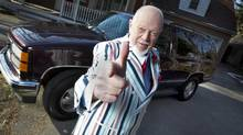 Don Cherry poses in front of his old 1997 Yukon before the vehicle was taken away as Mr. Cherry'd donation to the Kidney Foundationâs responsible vehicle recycling Kidney Car program, on March 14, 2013. (Peter Power/Peter Power/The Globe and Mail)