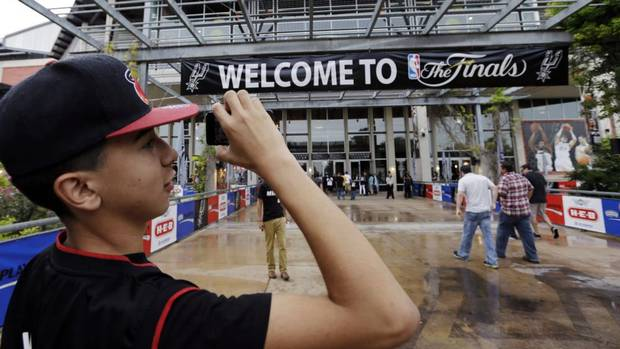 Miami Heat fan Johnathan Andrade arrives at the AT&T Center before Game 3 of the NBA finals basketball series against the San Antonio Spurs. (David J. Phillip/AP)