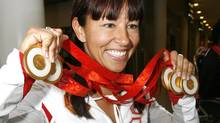 Canadian Paralympic athlete Chantal Petitclerc poses with the five gold medals she won at the 2008 Beijing Paralympic Games (MIKE CASSESE/REUTERS)
