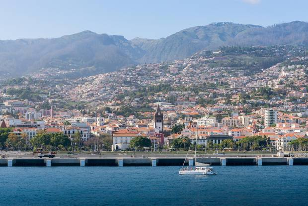 Located in a bay on the island of Madeira's southern coast, Funchal is the regional capital.