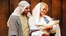 "Russell Peters as Joseph and Pamela Anderson as Mary in a scene from CTV's ""A Russell Peters Christmas"" (CTV)"