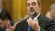 Transport, Infrastructure and Communities Minister Denis Lebel speaks in the House of Commons on Nov. 16, 2011. (Adrian Wyld/Adrian Wyld/The Canadian Press)