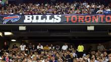 Fans enjoy the action during preseason NFL game action between the Pittsburgh Steelers and the Buffalo Bills at the Rogers Centre in Toronto, Thursday, August 14, 2008. THE CANADIAN PRESS/J.P. Moczulski (J.P. Moczulski/CP)